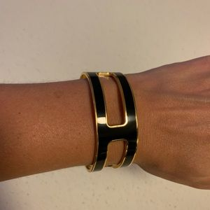 Coach black and gold cut out bangle